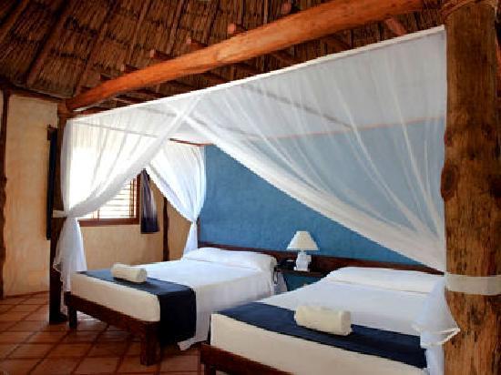 Xaloc Resort: interior cabañas dos camas