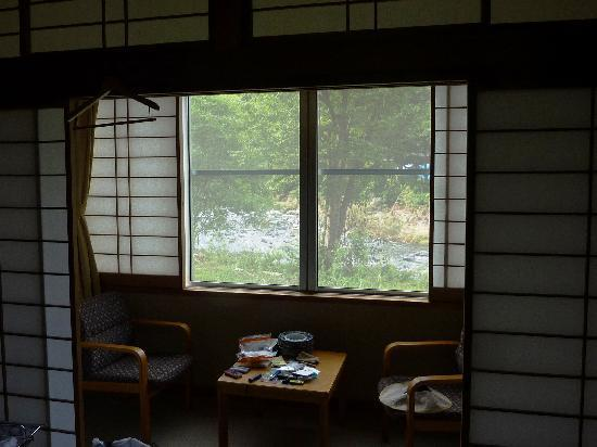 Dogenso: Bedroom window with a stream view