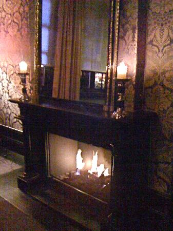 The College Hotel: fireplace downstairs bar