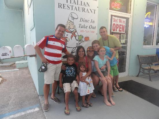 Upper Crust Pizza : At the door, my family and I on the right and good friends on the left.