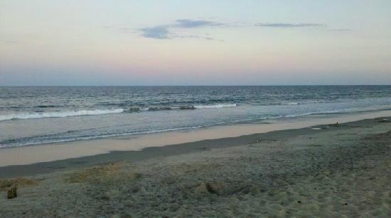 Refuge Inn: The beach in the evening