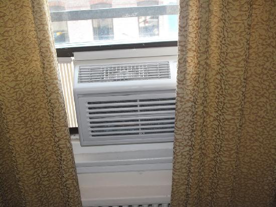 Chinatown Hotel: the ac unit for a 2 bedroom suite: cannot close curtains