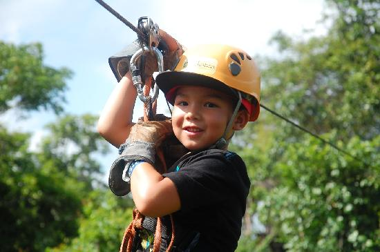 My 6 year old son on the zip line tour picture of selvatica cancun