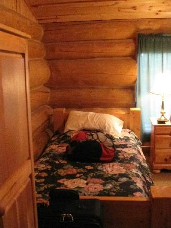 Main Lodge room, identical bed off to right