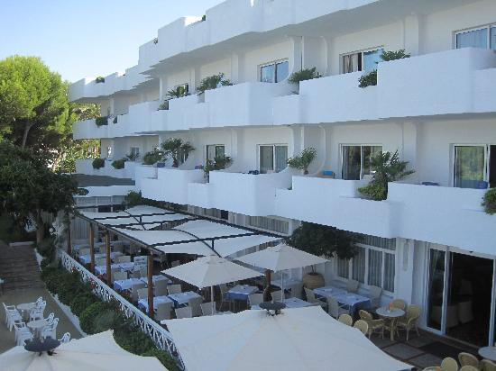 Hotel Rocamarina: view from sun terrace looking over outdoor dining area