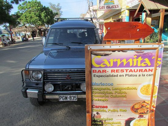 carmita: Partial view of the menu and the restaurant's surroundings.