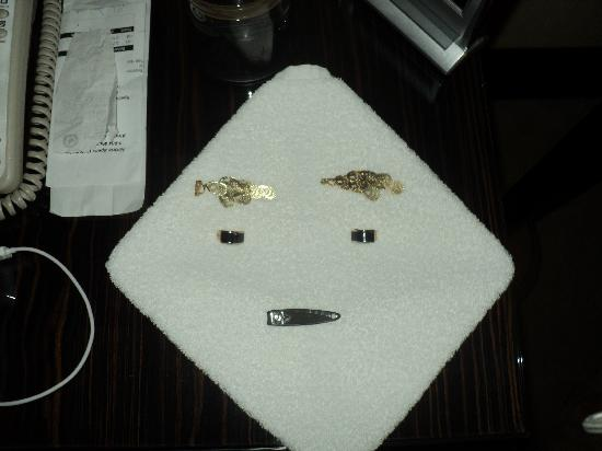 Fairmont Cairo, Nile City: An example of the day housekeeping staff's sense of humour; earrings and my nail clipper.