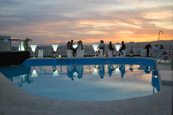 Rooftop pool at sunset picture of ac hotel malaga for Great rooms com