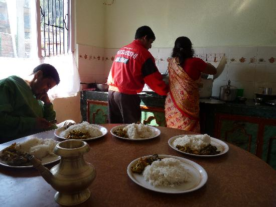 Mira's Home Stay: Mira and Sudarshan cooking in the kitchen