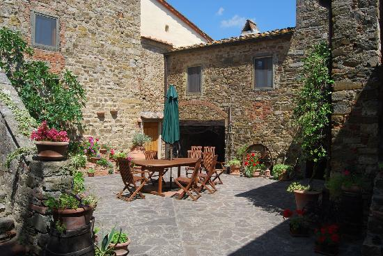Monte Poni: The Lovely Sunny, Flower-Filled Courtyard