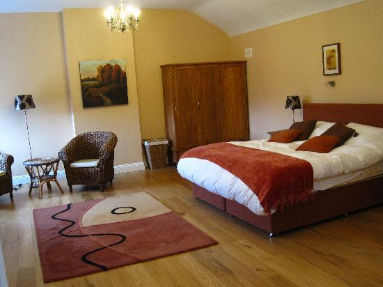 Decoy Country Cottages: our bedroom in the Tack Room cottage - massive. Bathroom, with jacuzzi bath, off to the left.