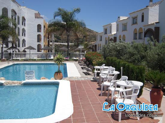 La Orquidea Holiday Apartments - View from the bar over the main pools.