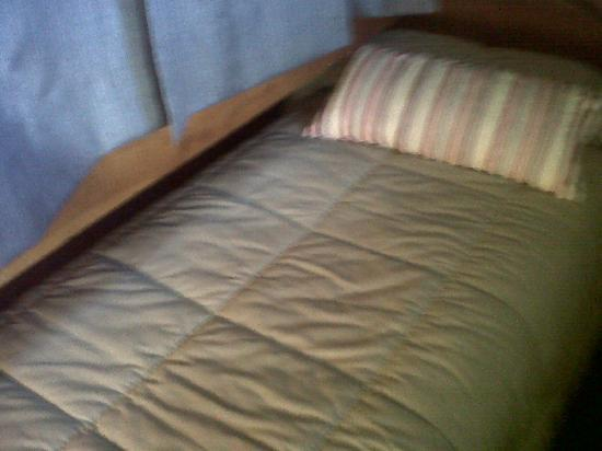 Cabañas Woodland: cama bajo viga