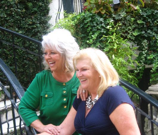 Paula Deen & Jennifer Salandi, owner on front steps of Ballastone