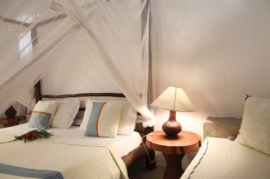 Raha Lodge Comfort Beach Villa : Camera da letto