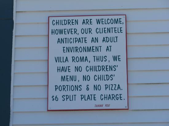West Harwich, MA: Sign outside Villa Roma discouraging families with children.