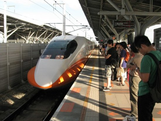 Taiwan High Speed Rail Taichung Station: The train is silent as it approaches.