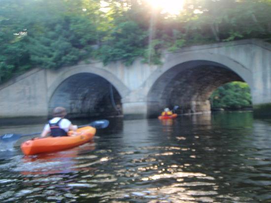 Kayak Excursions: Kayaking on the Mousam River, under an old railroad bridge.