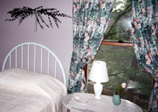The Turret House Bed & Breakfast : Whimsical and cozy, Lavender Oasis room has twin beds, so you can bring a friend and share the r