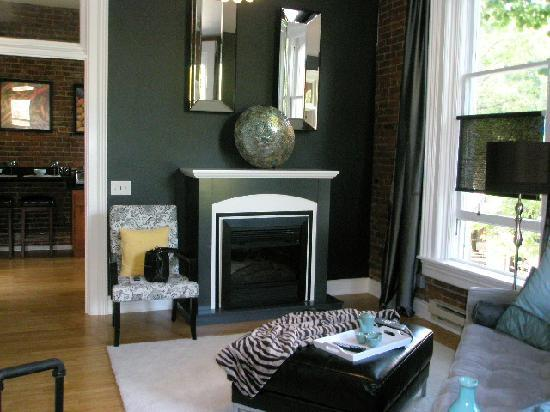 3rd Street Flats: Living room with fireplace