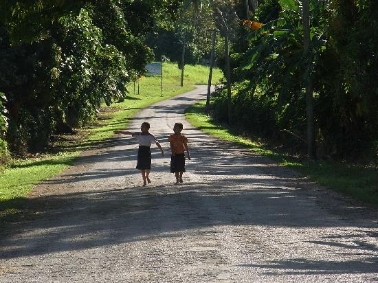 Heilala Holiday Lodge: Two young locals off to church on road leading to Heilala