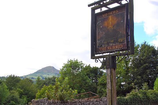 Skirrid Mountain Inn: The Skirrid Inn sign, with Skirrid Mountain in the background.