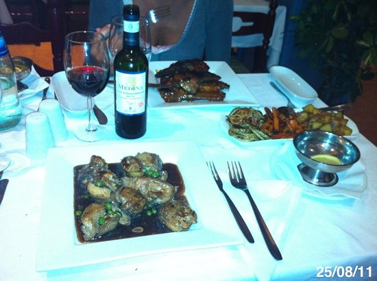 Malet Restaurant: tradicional rabbit & spare ribes followed by Red local wine