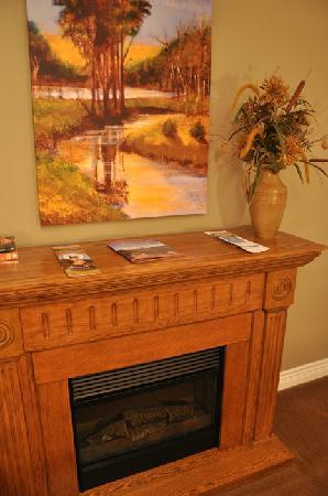 Wilbernics Bed and Breakfast: In-Room Electric Fireplace (End of the Bed)