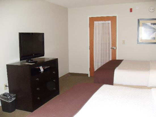 Holiday Inn & Suites Airport: showing door that separates the bedroom from the kichenette, LR, BR.