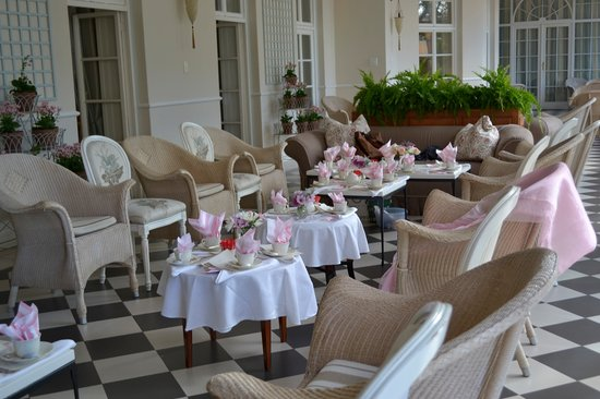 Planet Restaurant: The conservatory laid out for tea (napkins & flowers our own)