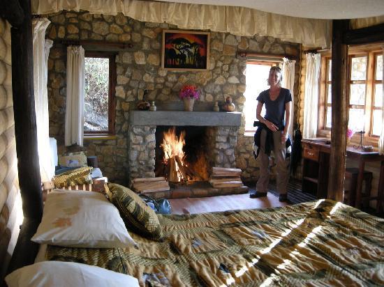 Mufindi Highland Fishing Lodge  Four poster bed and open fire. Four poster bed and open fire   Picture of Mufindi Highland