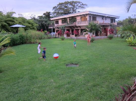 Playing soccer in the Villas Tranquilas grassy area