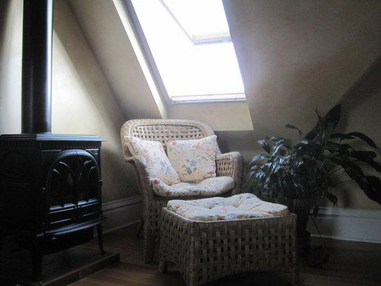 Edwards House: The perfect cool-weather place to read! A comfy chair under a window, next to a heater in the Au