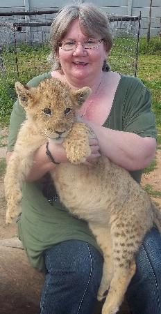 Daniell Cheetah Project: With a lion cub