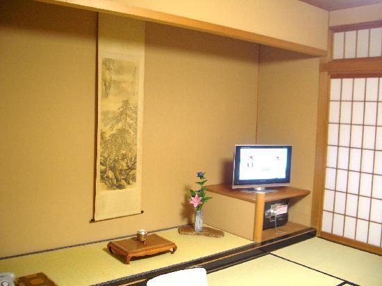Tsujinoya Hananosho: 生花の一輪挿しのおもてなし
