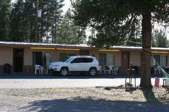 Whispering Pines Motel: room 6, with rental car in front