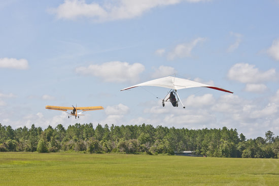 Groveland, FL: The ultralight airplane tows us up to the cloud base at 2500 feet.
