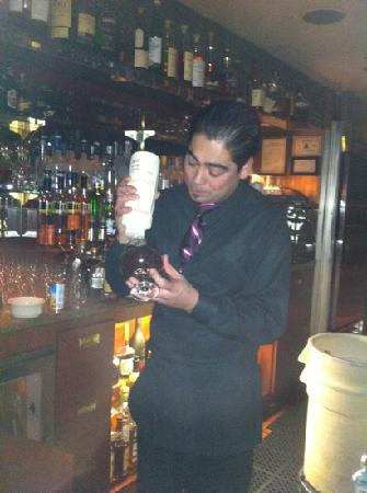 Hugo's Cellar: Dean making my amazing chocolate martini !! It was fabulous!