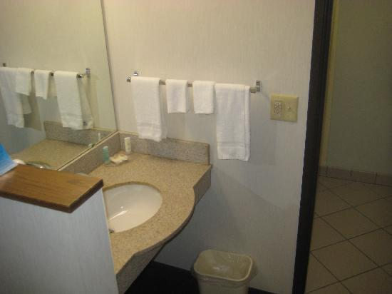 Quality Inn: The small sink is outside the bathroom and can't be used by more than one person