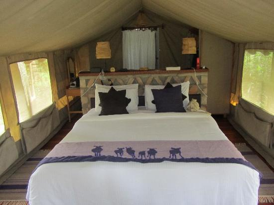 Our beautiful bed inside tent   Picture of Sarova Mara Game Camp