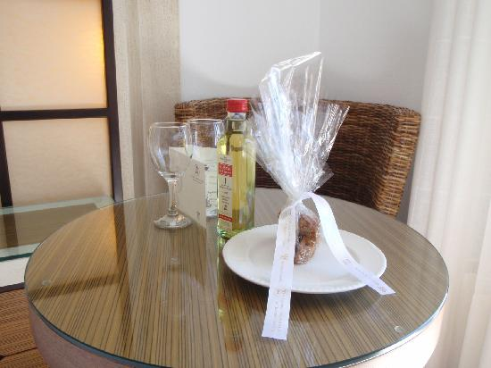 Myconian Ambassador Relais & Chateaux Hotel: welcome wine and biscuits in room