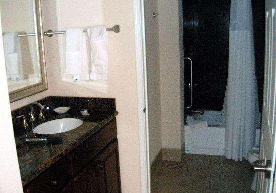 Staybridge Suites Great Falls: Compartmentalized bathroom.  Sink in alcove to left, large closet to right.