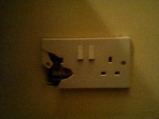 Falcon Hotel: Broken mains socket.