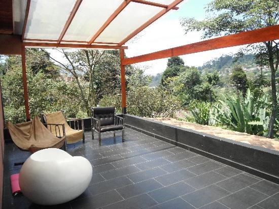 Secret Buddha Hostel Medellin: The terrace outside the Red Room