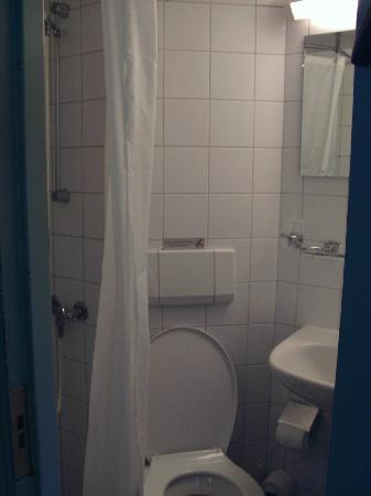 "Amstel Botel: The tiny bathroom, which rapidly became the ""wet-room"" due to the spray of the shower and poor d"
