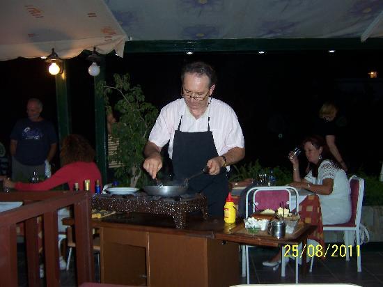 Avra Restaurant : owner preparing a meal