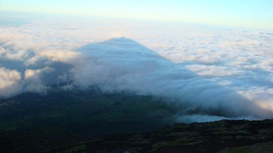 Shadow of Pico at sunrise in the clouds