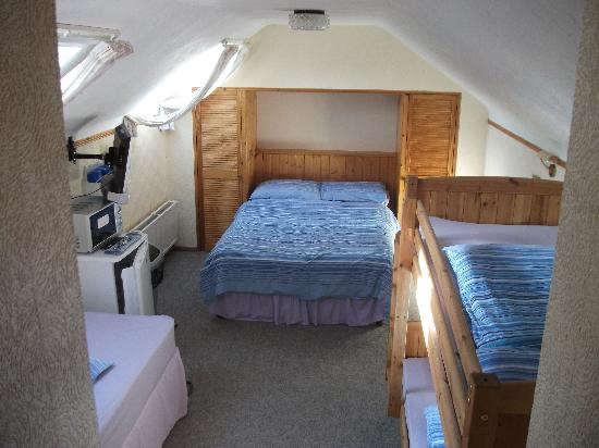 AbreakAway: The room toilet to right of camera, double bed ahead, single to the left and bunkbeds to the rig