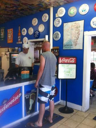 Lighthouse Pizza: the inside--the store owner and my husband