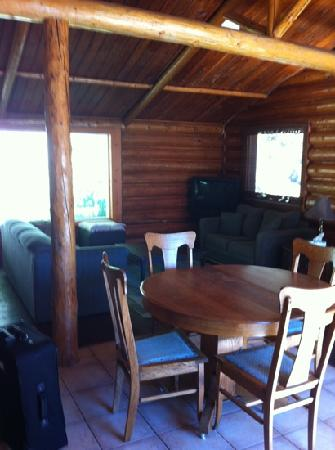 The Canim Lake Beach House : full dining room with wood burning stove and full living room both couches pull out for lots of